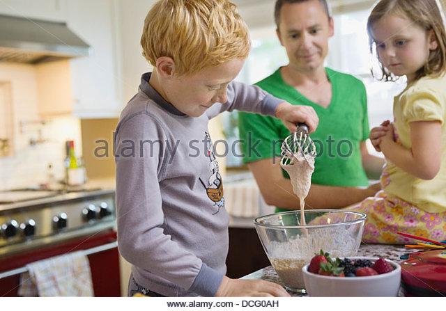 Little boy mixing waffle batter - Stock-Bilder