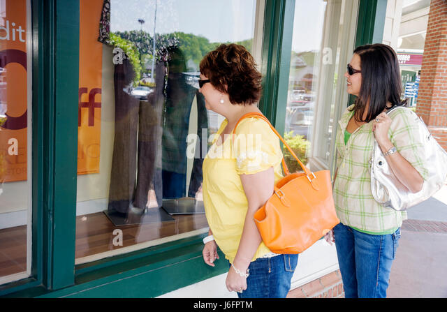 Tennessee Sevierville Tanger Outlets at Five Oaks shopping woman women girlfriends window shopping outdoor mall - Stock Image