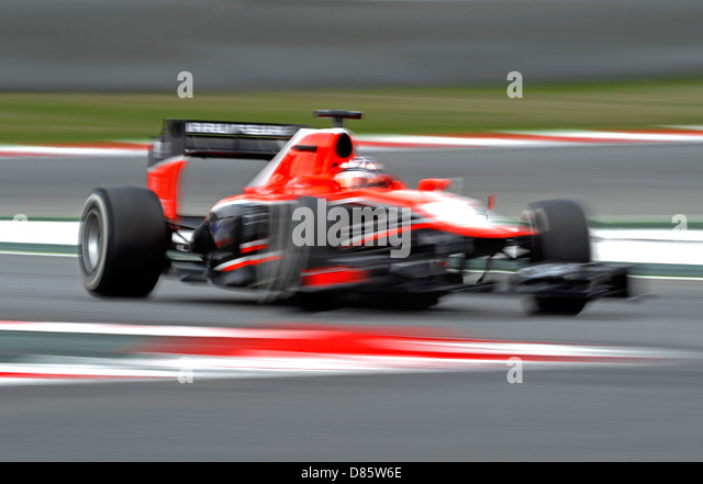 Marussia Formula One race car blurred by speed during the Spanish Formula One Grand Prix race 2013 - Stock-Bilder