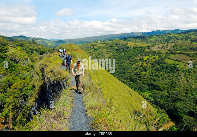 Hikers on Paso del Angel, a narrow pass in Santa Sofia, Villa de Leyva, Boyaca department, Colombia, South America - Stock Image