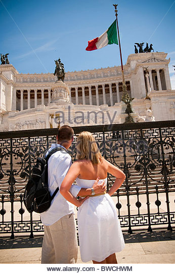 Couple admiring Altare della Pace Piazza Venezia Rome Italy - Stock Image
