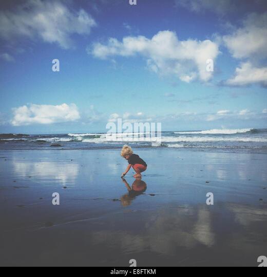 Boy playing on beach, california, america, USA - Stock Image