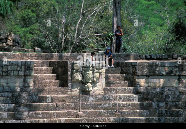 Honduras Copan Ruinas Maya ruins Mayan architecture tourists at the sculpture of the Venus God horizontal tourism - Stock Image