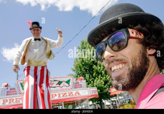 Wisconsin Kenosha Kenosha County Fairgrounds The Ultimate Kid Fest family event tall man men stilt walker carnival - Stock Image