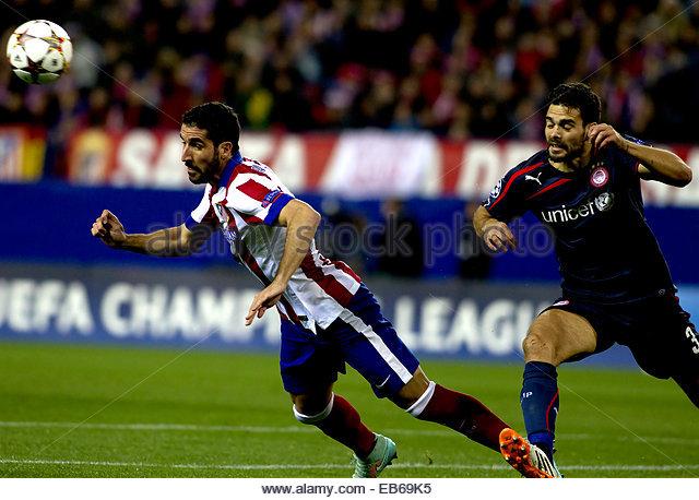 SPAIN, Madrid: Atletico de Madrid's Spanish midfielder Raul Garcia and Olympiacos Spanish Defender Alberto Botia - Stock Image