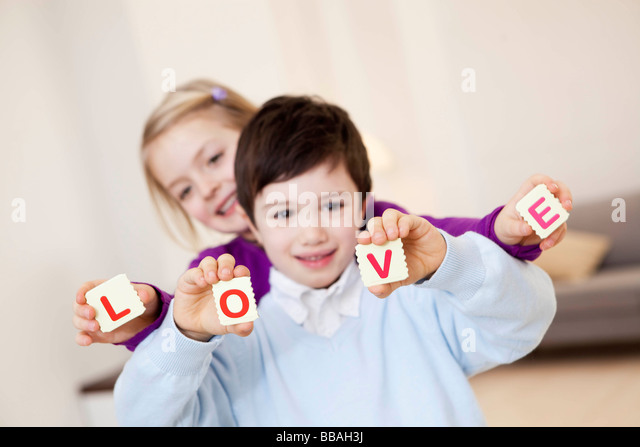 kids showing love-characters - Stock Image