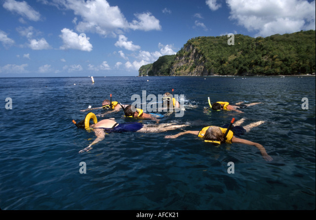 West Indies St. Lucia Anse Chastanet Resort Caribbean Sea visitors snorkeling - Stock Image