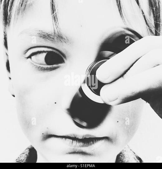Boy with a fidget spinner - Stock-Bilder