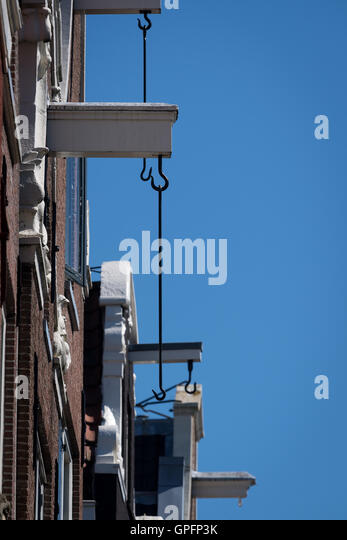 Classic Amsterdam gabled buildings with hook for hoisting goods and equipment - Stock Image