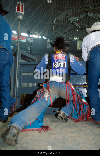 Texas The Southwest Houston Astrodome annual Livestock Show & Rodeo bull rider stretches before competing TX011 - Stock Image