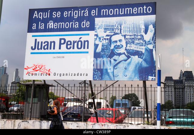 Argentina Buenos Aires Avenida Corrientes street scene sidewalk billboard announcement Spanish language Juan Peron - Stock Image
