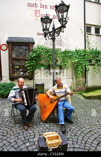 Two German musicians play the Balalaika and the accordion in the old town of Traben-Trarbach, Germany in the Rhineland. - Stock Image