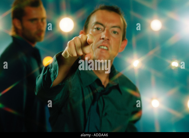 angry young man pointing - Stock Image