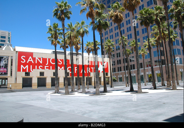 plaza with palm trees outside san jose museum of art downtown san jose california - Stock Image