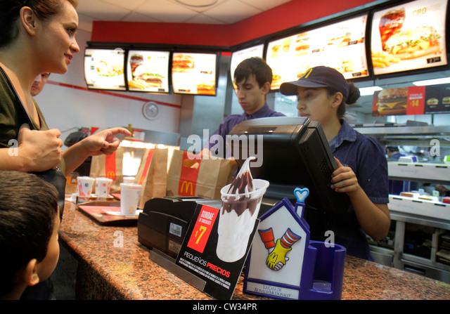 Buenos Aires Argentina Avenida Callao McDonalds restaurant fast food hamburgers global chain Hispanic man woman - Stock Image