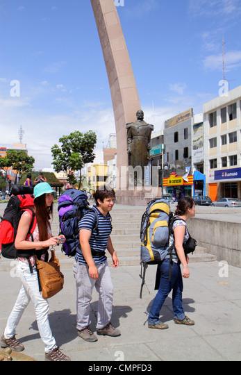 Peru Tacna Avenida San Martin Plaza de Armas public park square Arco Parabolico parabolic arch monument statue bronze - Stock Image