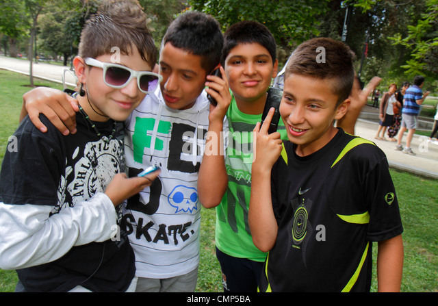 Santiago Chile Parque Forestal urban park reclaimed land Hispanic boy child tween student preadolescent fashion - Stock Image