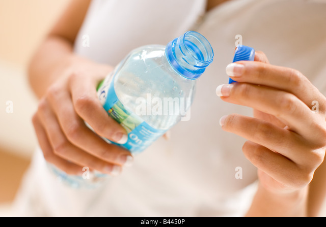 Close up of bottled water - Stock Image