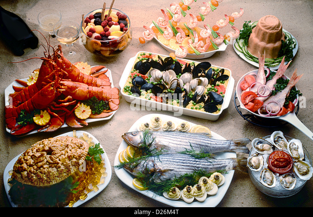 seafood on sand - Stock Image