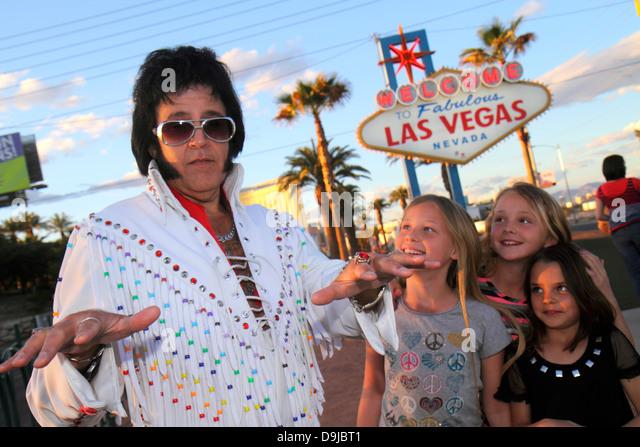 Nevada Las Vegas South Las Vegas Boulevard The Strip Welcome to Fabulous Las Vegas sign landmark historic man Elvis - Stock Image