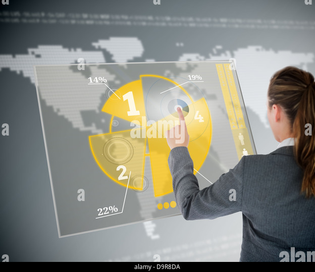 Well dressed business woman using yellow pie chart futuristic interface - Stock Image