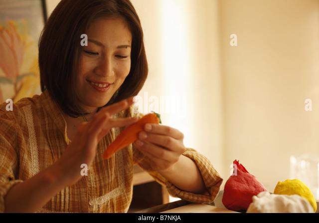 A woman making handicraft items - Stock Image