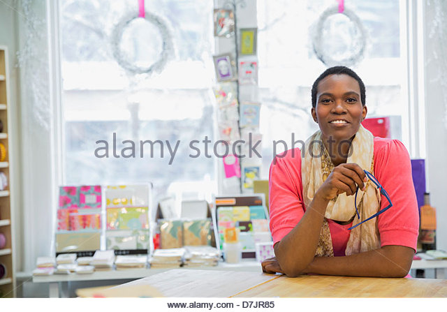 Portrait of female small business owner in store - Stock Image