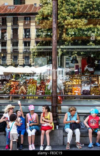 Spain Europe Spanish Hispanic Madrid Centro Mercado de San Miguel market shopping family boy girl - Stock Image