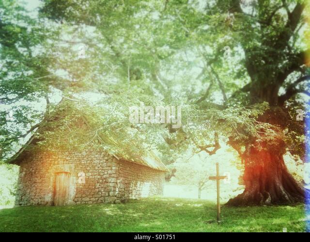 Small stone chapel at Le Mas Saint-Jean, Saint-Sulpice-le-Dunois, La Creuse, Limousin, France - Stock Image