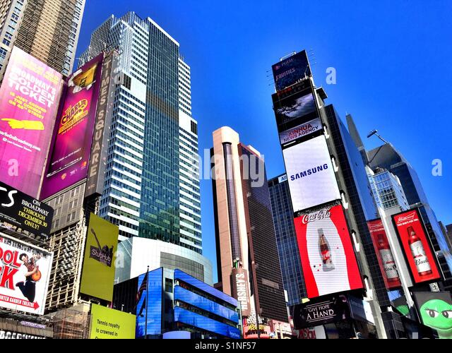 Skyscrapers covered in advertising billboards, Times Square, New York City USA - Stock Image