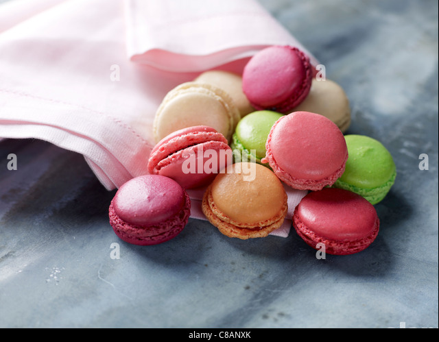 Different-flavored mini macaroons - Stock Image