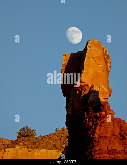 The moon rising over Chimney Rock, Capitol Reef National Park, Utah, United States of America - Stock Image