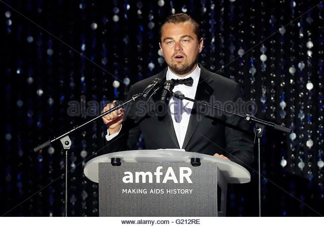 epa05318109 US actor Leonardo DiCaprio speaks on stage during the auction dinner of the Cinema Against AIDS amfAR - Stock Image