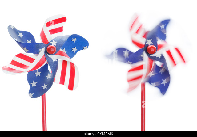 Two stars & stripes pinwheels, one stationary, one spinning, isolated - Stock Image
