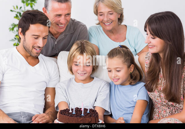Family celebrating young boys birthday - Stock Image