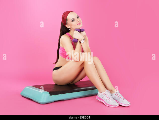 Recreation. Slender Calm Woman with Dumbbells Relaxing - Stock Image