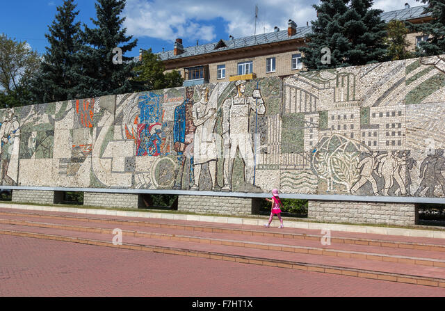 Mosaic on the central square in front of the house of culture named after Kalinin in Korolev - Stock Image
