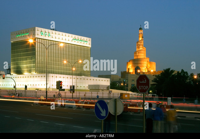 Qatar Doha Main Central Bank near main mosque at night - Stock Image