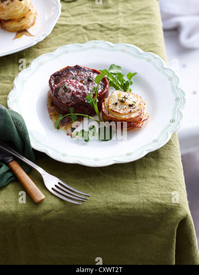 Plate of beef proscuitto steak - Stock Image