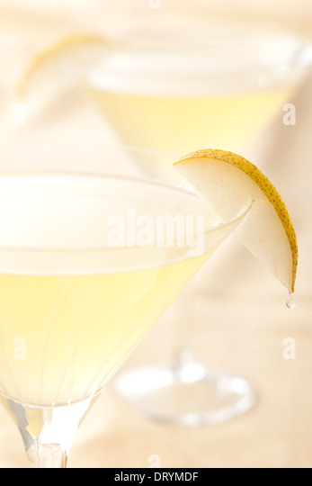 Two citrus and pear martini cocktails with St. Germain Elderflower liqueur, vodka and pear juice - Stock Image