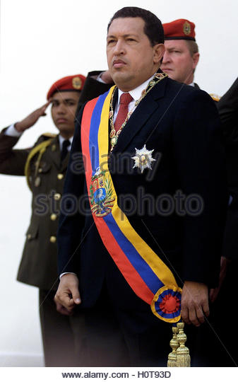 Venezuelan President Hugo Chavez stands at attention during a ceremony  at the National Assembly in Caracas, January - Stock Image