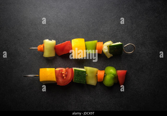 Vegan skewers on the table, from above - Stock Image