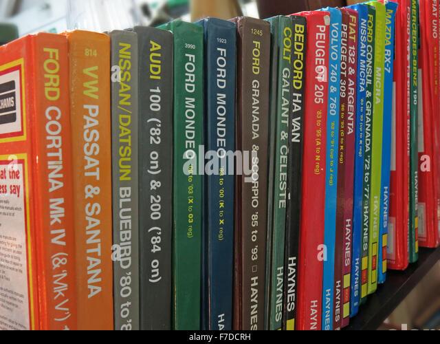Bookshelf of Haynes car maintenance manuals, England, UK - Stock Image