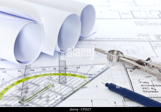 Still life photo of architectural floor plans with drawing instruments - Stock-Bilder