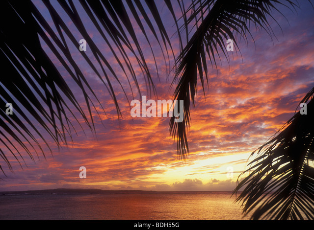 Sunset from the Pacific Islands Club resort with Tinian Island in the distance; Saipan, Northern Marianas Islands, - Stock-Bilder
