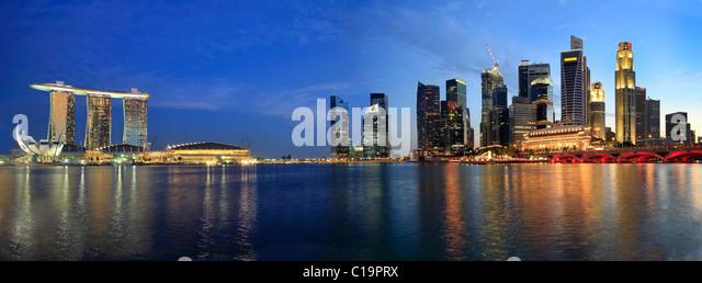 Singapore Skyline from Marina Bay Esplanade at Night Panorama - Stock Image