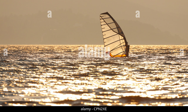Windsurfing at sunset - Stock-Bilder