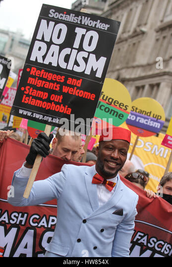 London, UK. March 18, 2017: A demonstrator holds up a placard with the words 'No To Racism' during the Stand - Stock Image