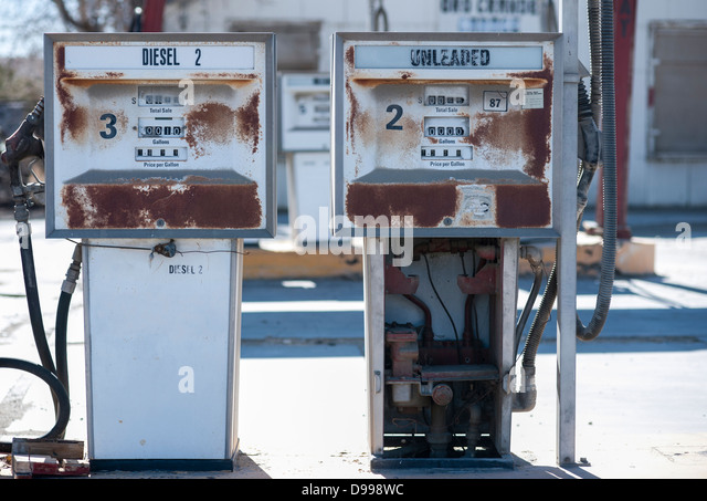 Old rusty gas pumps of abandoned gas station - Stock Image