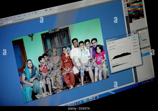 Photographer,Graphic artist,Designer,Image processing,Working,Girl,Group of peoples,Computer,Desktop,graphic program,Software - Stock Image